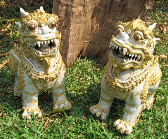 Pair of Celadon Ceramic Foo Dogs